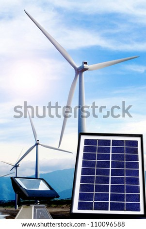 A wind turbine a solar panel and a lamp powered with renewable energy - stock photo