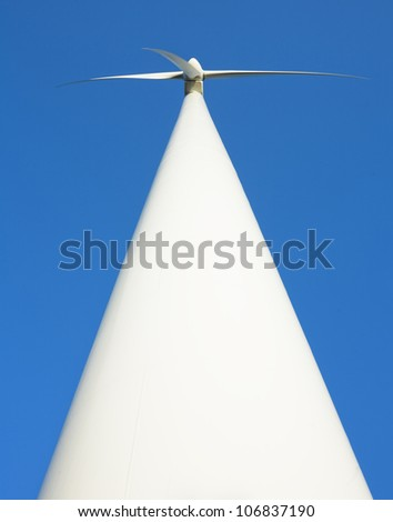 A wind turbine against a blue sky, Sweden. - stock photo