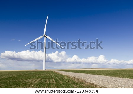 A wind turbine in a farmers field
