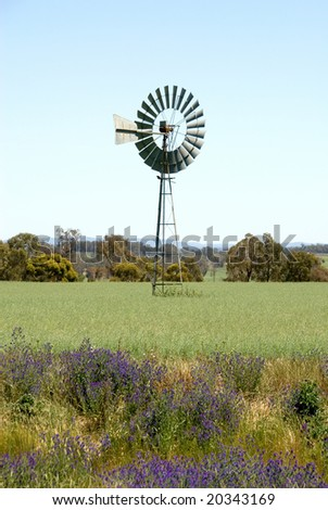A windmil on a farm, near Young, New South Wales, Australia - stock photo
