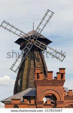 A windmill and a brick tower in the foreground, the Kremlin, Moscow Izmalyovo