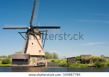 A windmill at Kinderdijk. GPS information is in the file - stock photo