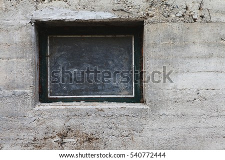 a window in concrete wall