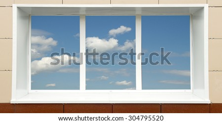 a window in the house, the sky clouds in a glass