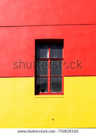 A window on red and yellow background.