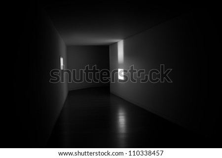 A window providing light in the side of a black tunnel  It represent that there is light in the side and not just in the end of the tunnel.