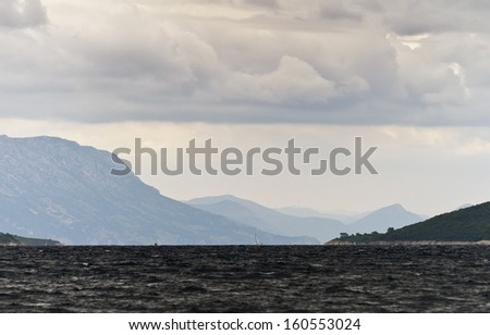 A windy and rainy day on the sea - stock photo