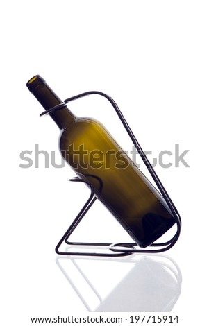 A wine bottle  in a bottle-holder isolated in white background.  - stock photo