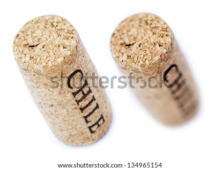A wine cork with 'Chile' written on it, isolated on white background, shot diagonally from a high angle..Two types of depth of field - shallow and deep. - stock photo