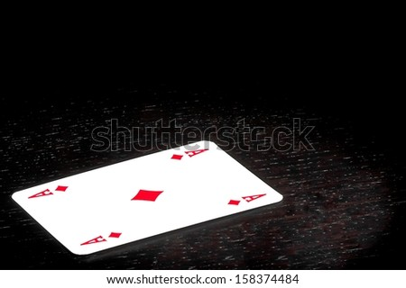 a winning ace on old wood table