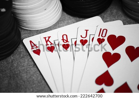 A winning poker hand of Hearts Royal Flush Cards, black and white background - stock photo