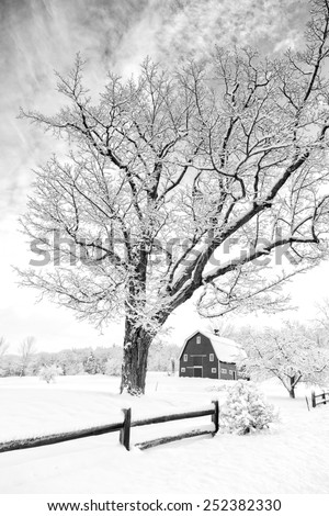 A winter farm landscape in New England. - stock photo