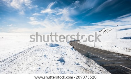 A winter road over mountain passage between Oslo and Bergen in Norway - stock photo