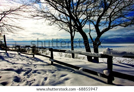 a winter scene by the lake