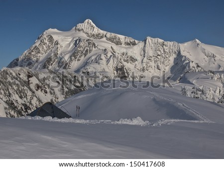 A winter tent is pitched near Artist Point along Huntoon Ridge in Northern Washington State with Mt. Shuksan in background. - stock photo