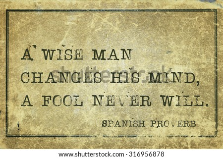 A wise man changes his mind - ancient Spanish proverb printed on grunge vintage cardboard - stock photo