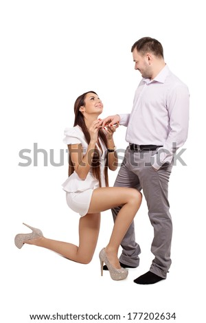 A woman asks her husband's forgiveness. Wife strongly requests apologies before her man. Young girl makes a bid for man. Lady asks to marry me. Beg to marry myself. Woman making a marriage proposal. - stock photo