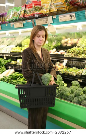 A woman at the supermarket shopping for groceries