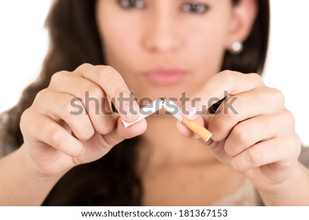 A woman breaking cigarette. concept stop smoking