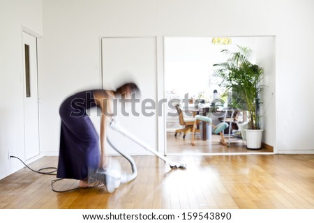 A woman cleaning the home