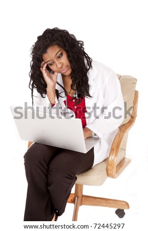 A woman doctor with a laptop is sad. - stock photo