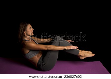 A woman doing a crunch working out her stomach.