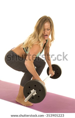 a woman doing a dead lift with a barbell.