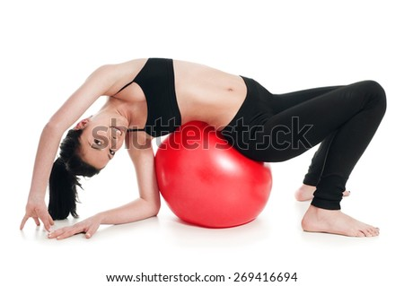 A woman doing exercise for stomach muscle with fitness ball