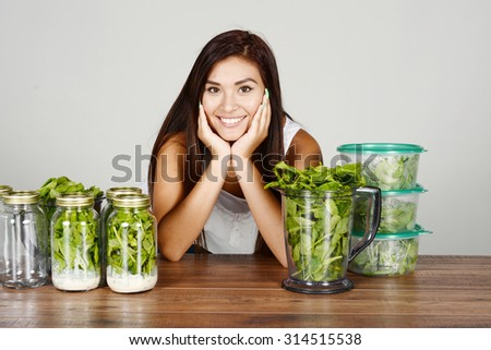 A woman doing meal prep for the week - stock photo