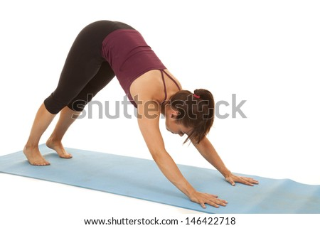 a woman doing some yoga to cool down.