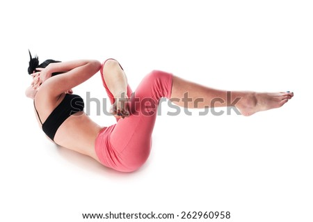 A woman doing stomach's exercises - stock photo