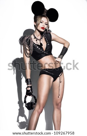 A woman dressed as a fashion mouse with big ears.  Fashion art photo - stock photo