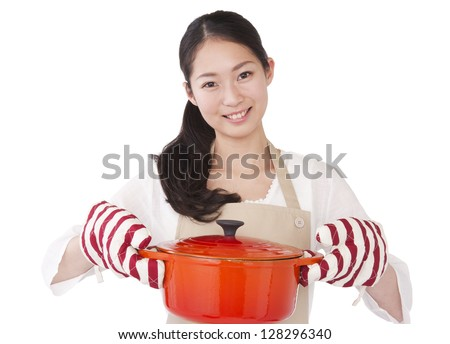 A woman dressed in apron with a pot