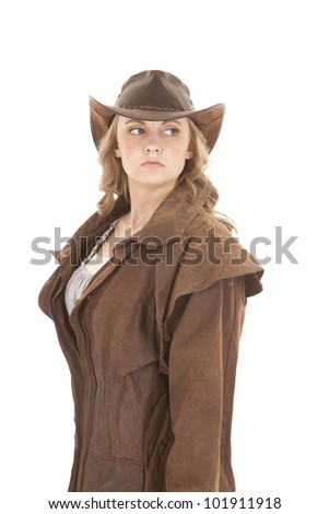 A woman dressed in western attire looking to the side. - stock photo