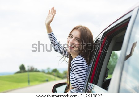 A Woman driver who is happy to have is new car