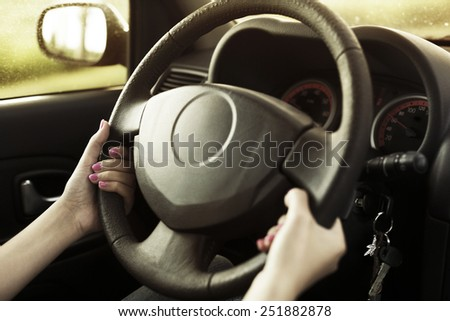 A woman driving her car. - stock photo
