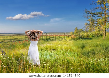 A woman early in the morning in a field of flowers