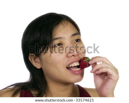 A woman eat strawberry with white background