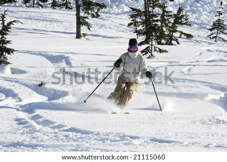 A woman enjoying skiing on powder