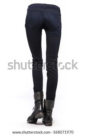 A woman(female, girl, model) wearing black pants(jeans, denim, trousers), black boots(walker) side view close up isolated white at the studio. - stock photo