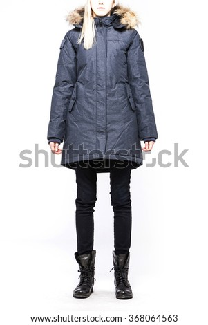 A woman(female, girl, model) wearing grey jumper, blue pants(jeans, denim, trousers), brown boots(walker) for winter close up isolated white at the studio.