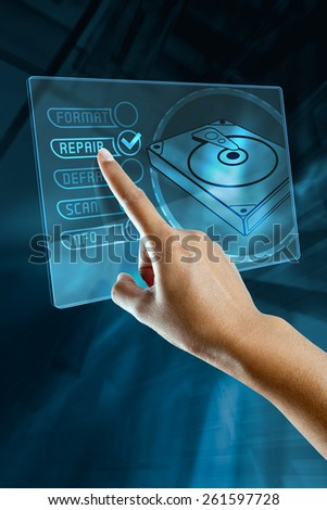 a woman finger choice a option to repair a hard disk on a digital screen - stock photo