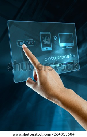 a woman finger transfer data on a digital screen - stock photo