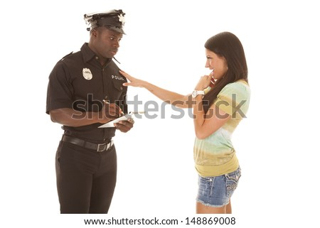 a woman flirting with a policeman to get out of a ticket. - stock photo