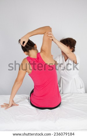 A woman getting a massage - stock photo
