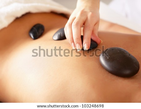 A woman getting spa treatment, isolated on white - stock photo