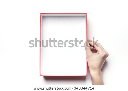 A woman(girl, female) hands hold a red empty(vacant, hollow, blank) gift box(package, container) for christmas, birthday, holiday isolated white at the studio. - stock photo