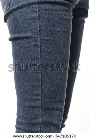 A woman(girl, female) wearing blue denim pants and white sweater close up  isolated white at the studio.