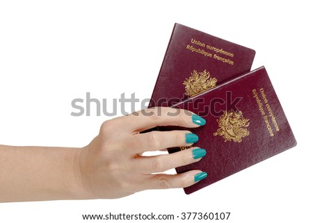 a woman hand with two French Passports isolated, on white background