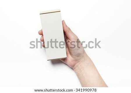 A woman hands hold a empty(blank, vacant, hollow) white paper box(package) for cosmetics, accessory, top view isolated white at the studio. - stock photo